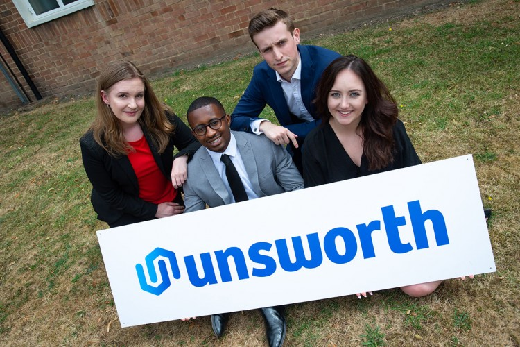 Apprenticeships Deliver For International Logistics Firm Unsworth: Three Unsworth employees/freight forwarders holding logo/sign
